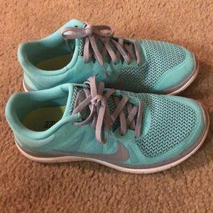 Tiffany blue women's Nike free runs